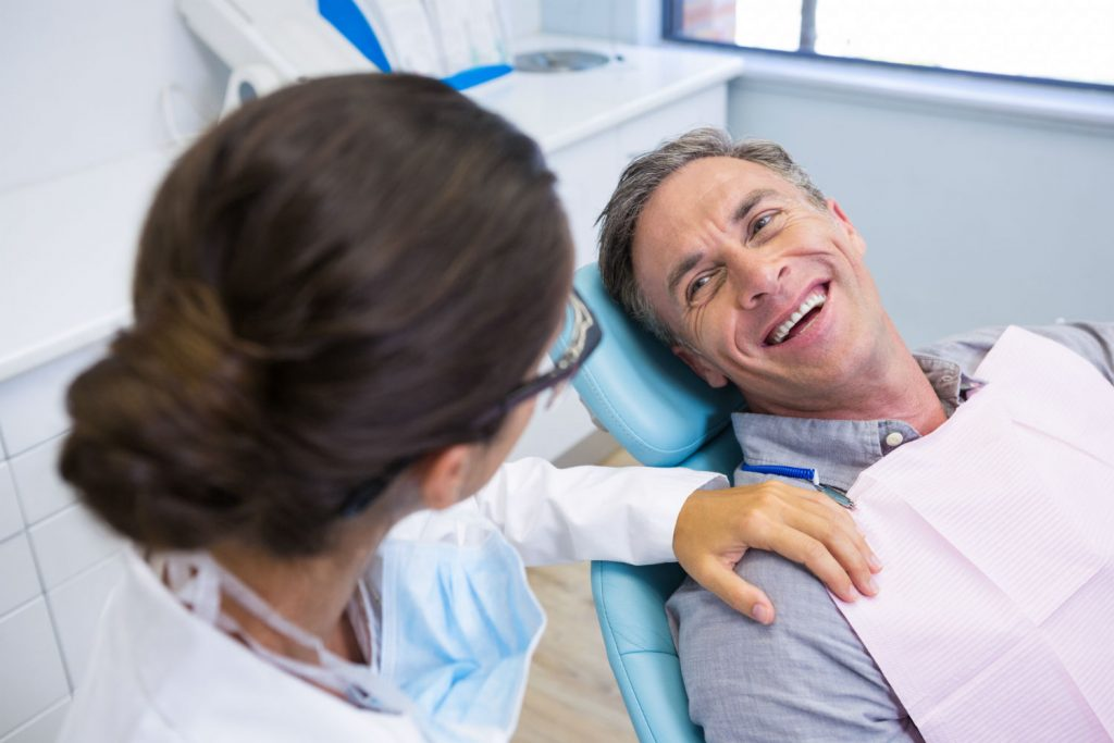 bigstock-Happy-patient-sitting-on-chair-209890804-1-1024x683 Our Services dentist Winthrop, NY